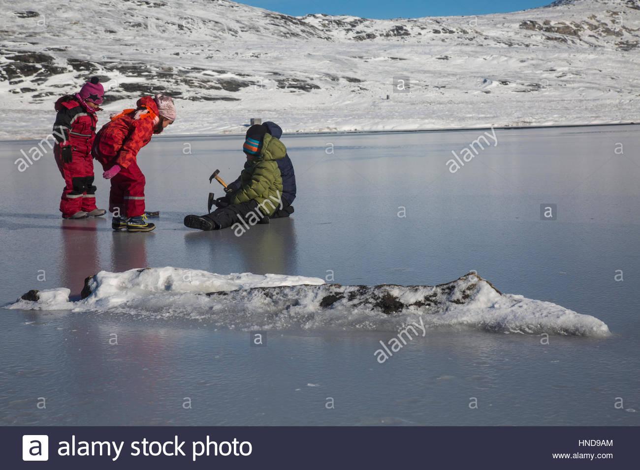 Greenlandic Children Playing on Ice Stock Photo