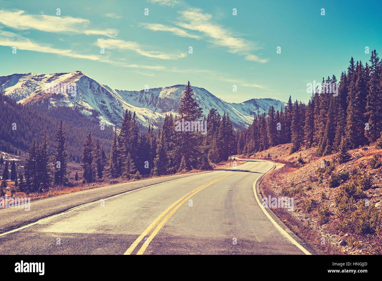 Retro color toned Rocky Mountains road, Colorado, USA. - Stock Image