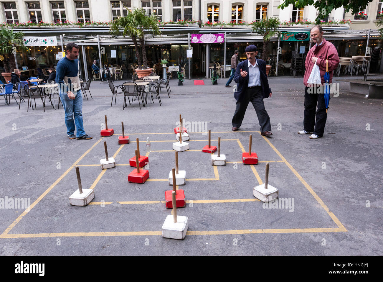 Locals playing street game looks like Nine Men Morris, Bern, Switzerland Stock Photo