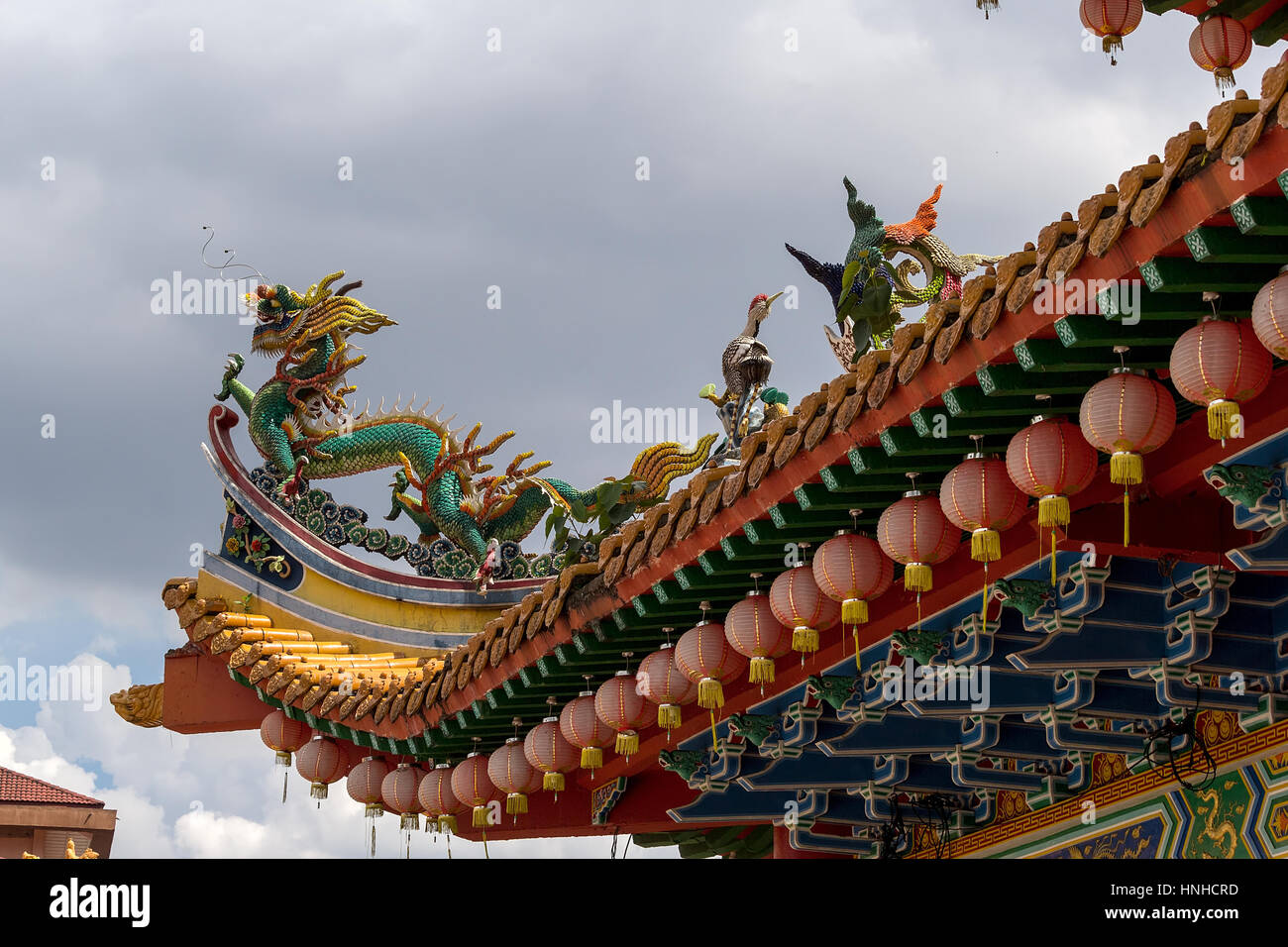 Dragon and Crane Mythical Creatures on Chinese Temple Roof Top - Stock Image