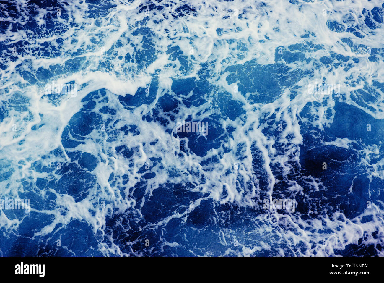 Background blue waves of the sea. - Stock Image