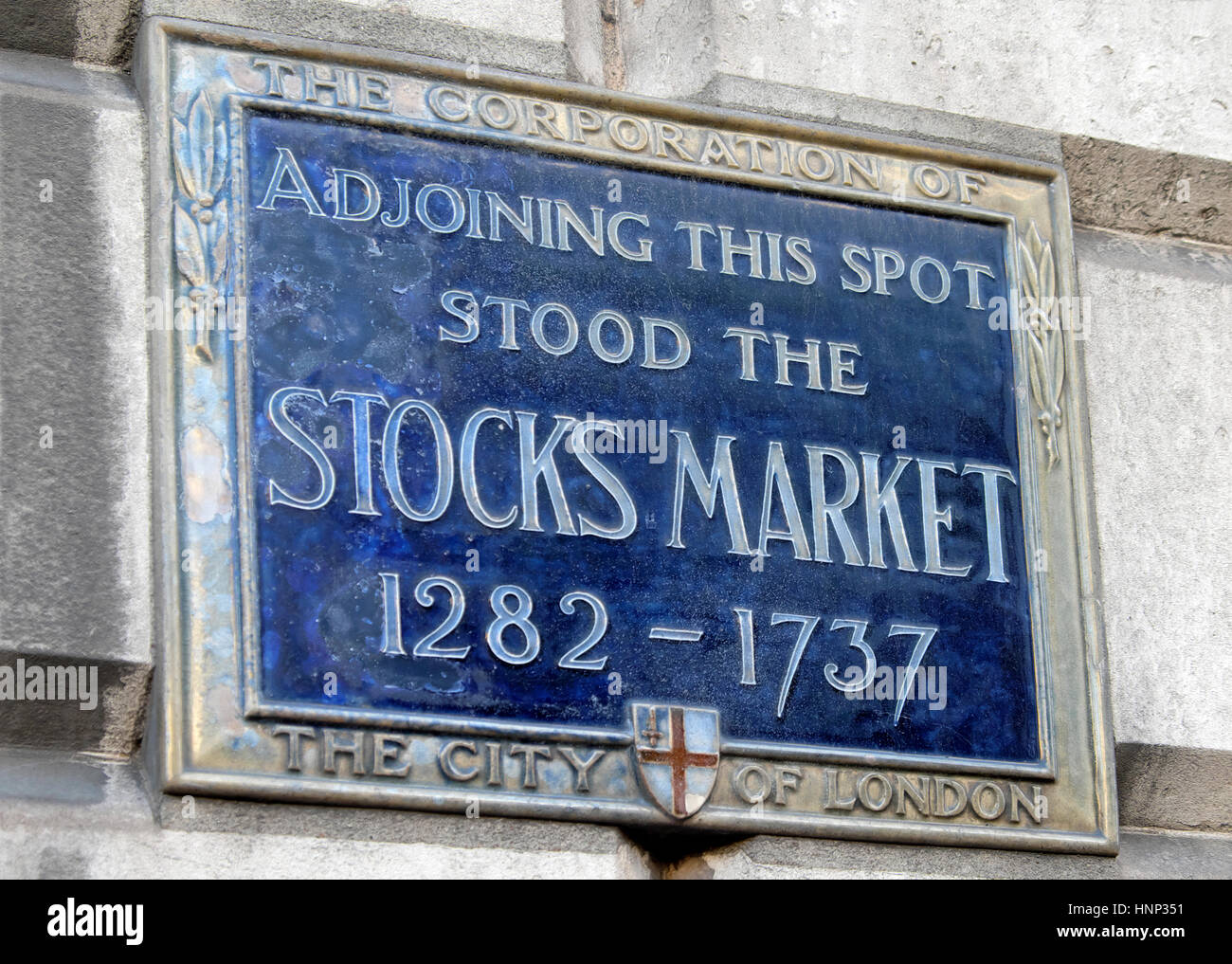Corporation of London blue plaque for the London stock stocks market site  from 1282 - 1737 on a building in the City of London, UK KATHY DEWITT