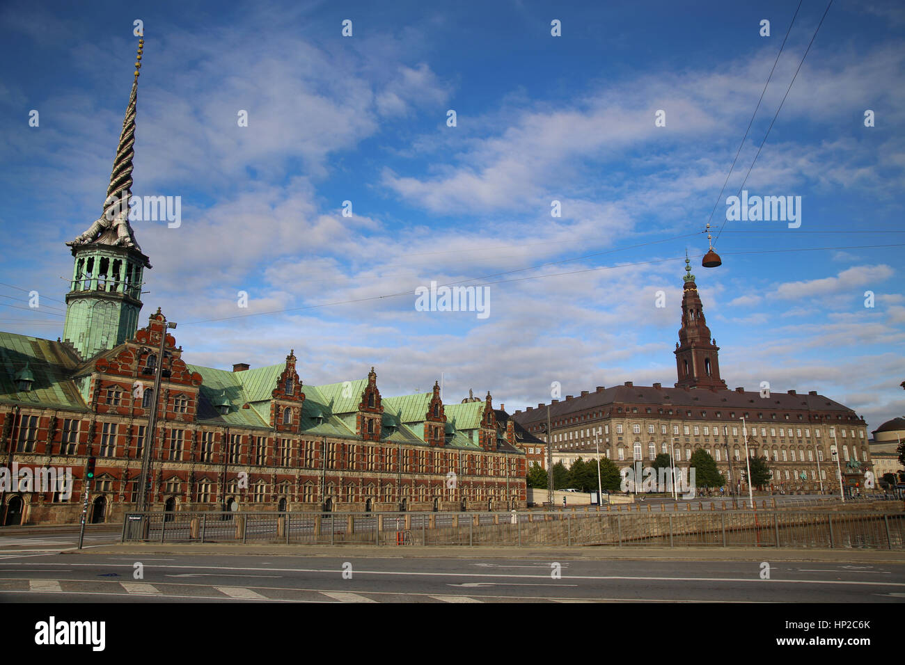 Morning view on Christiansborg Palace and The Borsen, Oldest Building in Slotsholmen, Copenhagen, Denmark - Stock Image