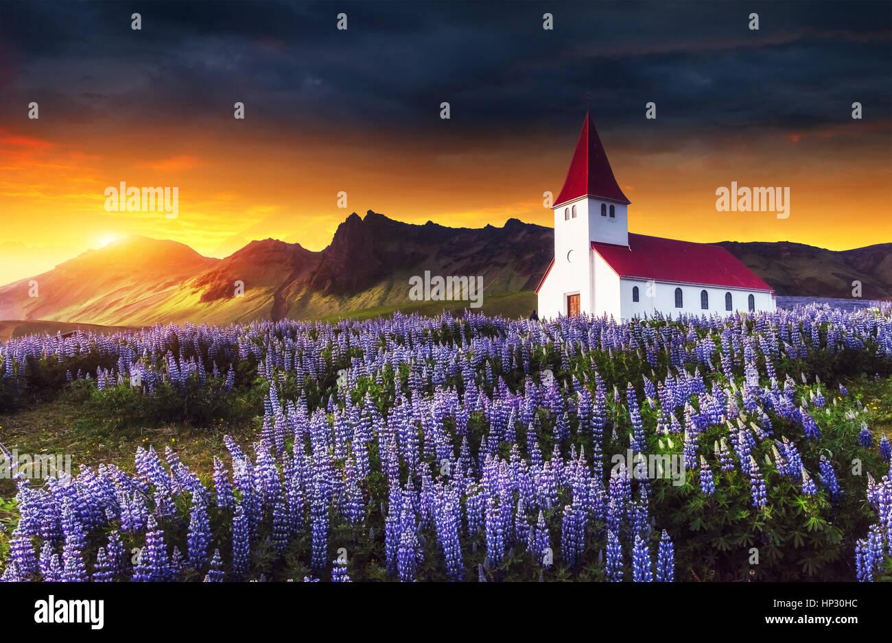 Lutheran church in Vik. Fantastic sunset. Iceland - Stock Image