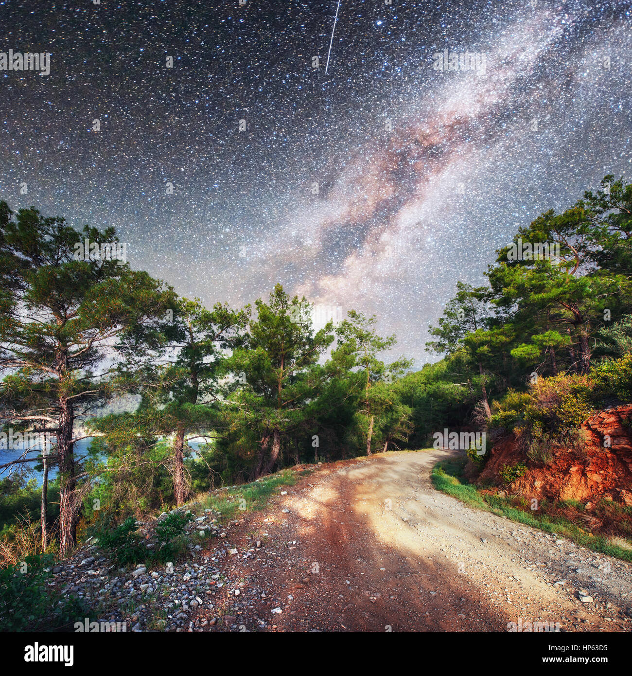 Fantastic starry sky and majestic mountains in the mist. Dramatic  beautiful morning. Autumn landscape. Courtesy - Stock Image