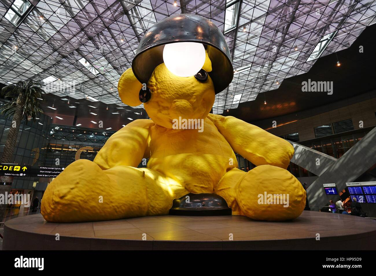 A Canary Yellow Lamp Teddy Bear Sculpture In The Middle Of The Terminal At  The Hamad International Airport (DOH) In Doha, Qatar