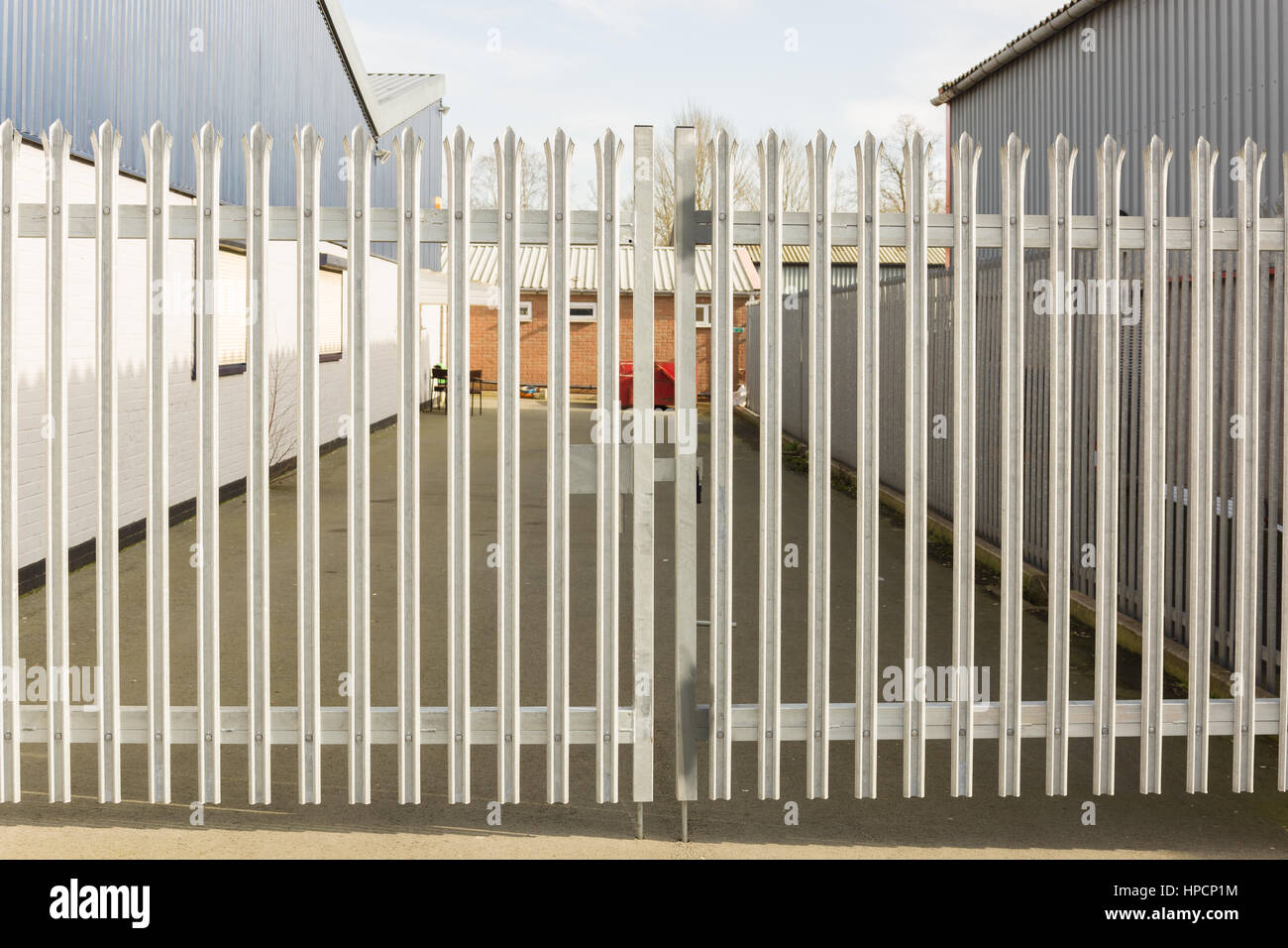 Set of locked spiked security gates at an industrial or commercial premises Stock Photo