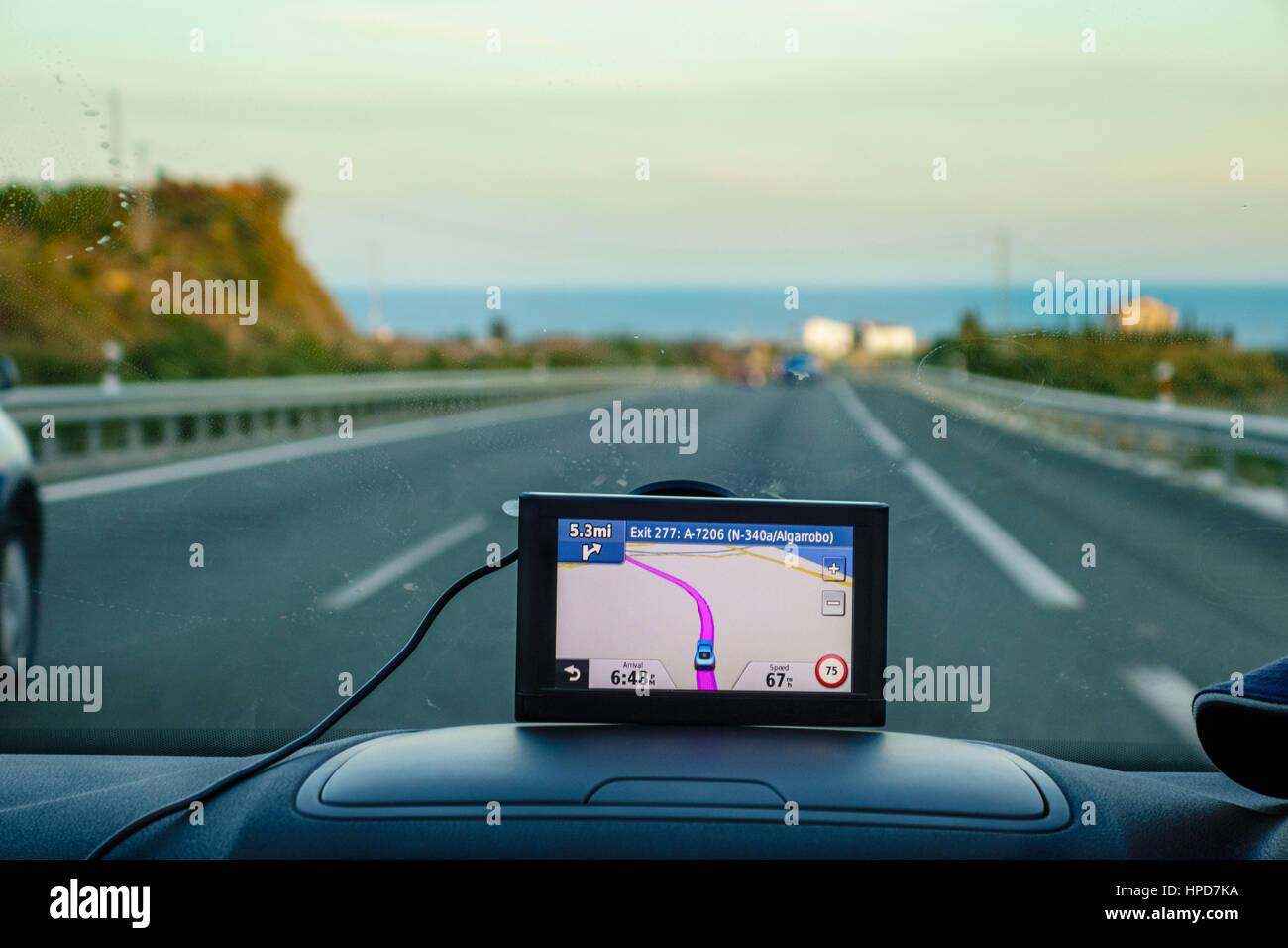 Satnav, Sat nav, or gps satellite navigation in car. UK car with satnav on dashboard Costa del Sol Spain. Looking Stock Photo