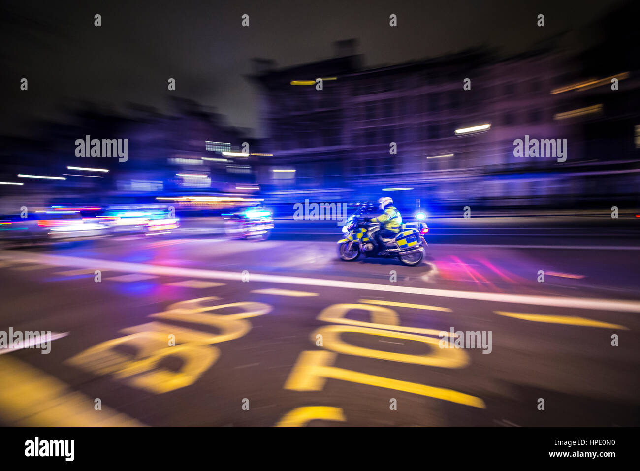 a-police-motorcycle-racing-to-an-incident-at-night-along-whitehall-HPE0N0.jpg