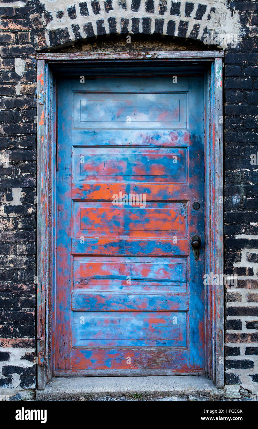 Old vintage dilapidated door with cool peeling paint, and lots of character. - Stock Image