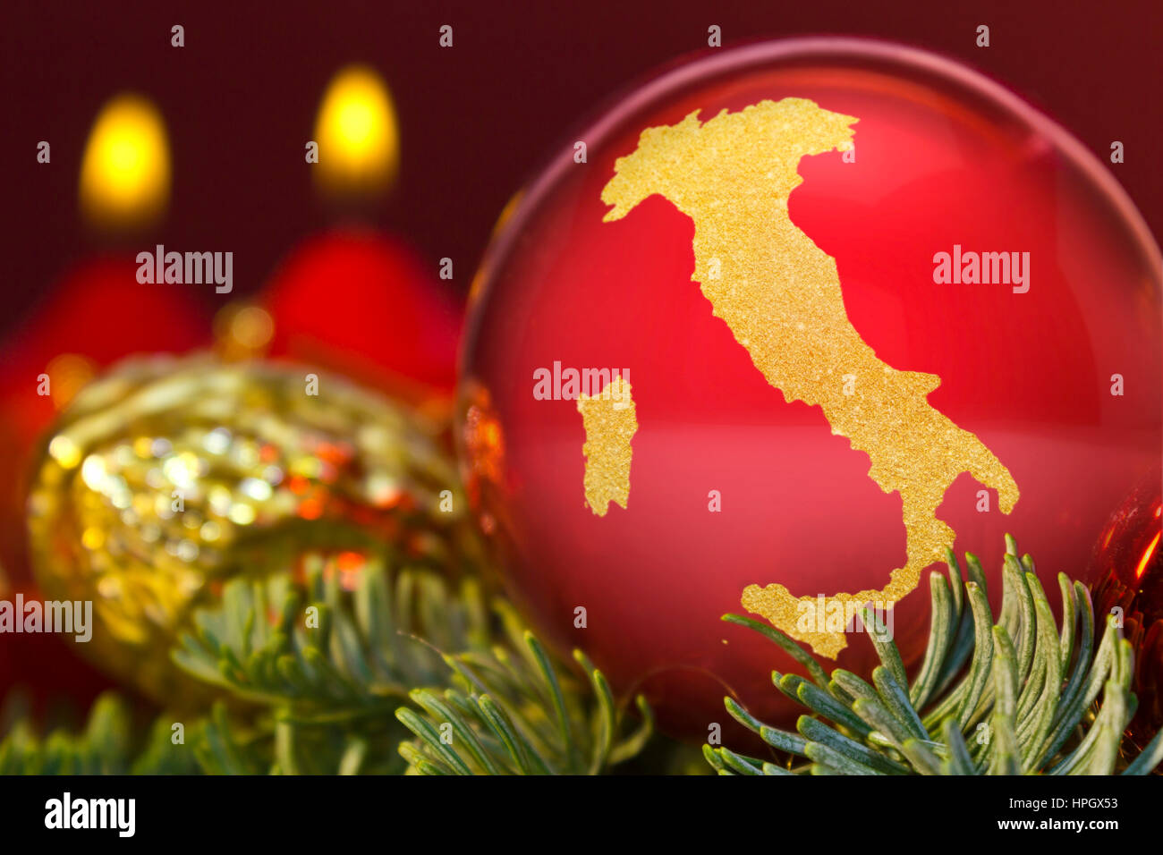https://c7.alamy.com/comp/HPGX53/a-glossy-red-bauble-with-the-golden-shape-of-italyseries-HPGX53.jpg