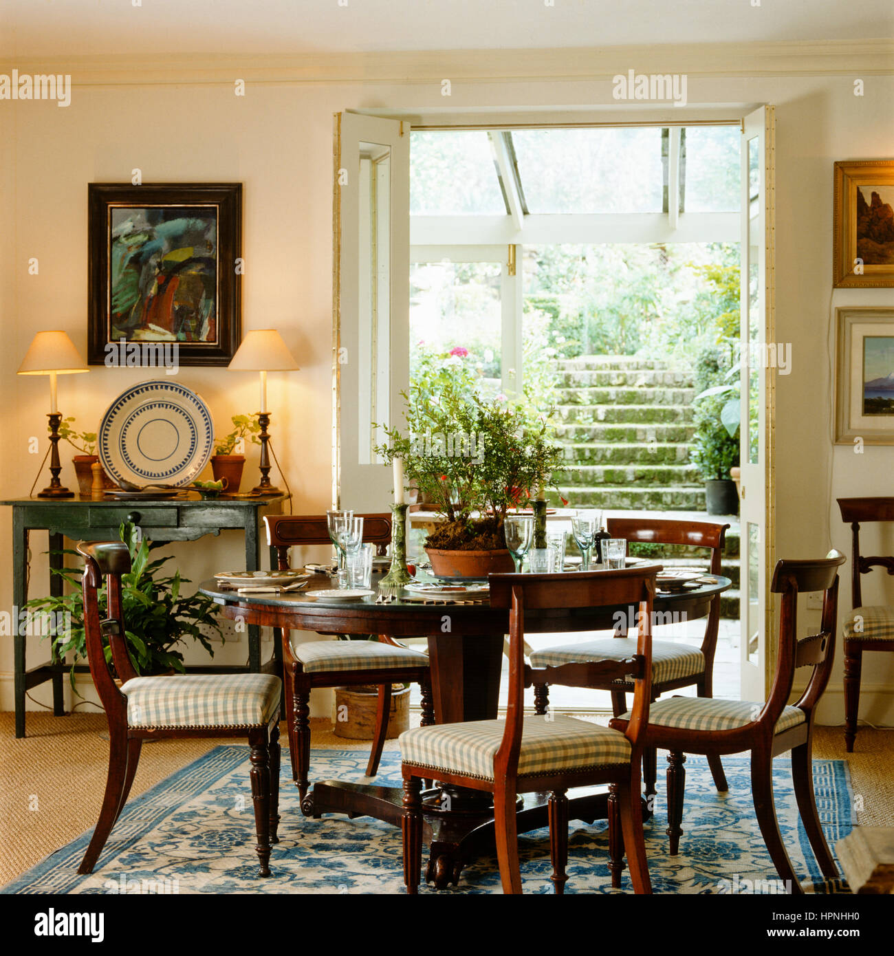 a country style dining room with french doors leading outside stock rh alamy com decorating dining room country style country style dining room hutches