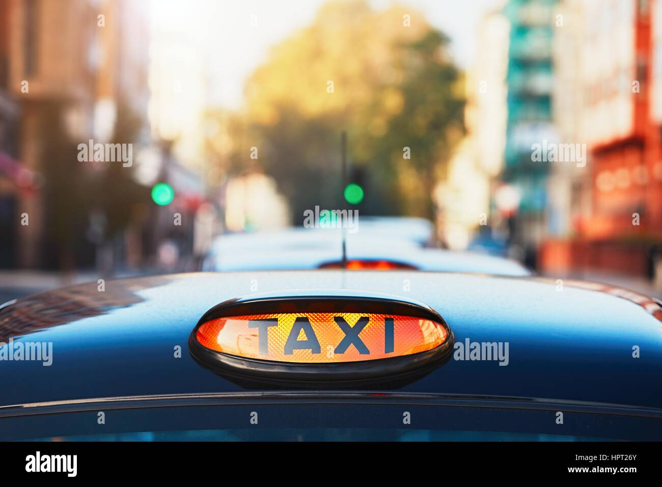 London black taxi cab sign on the street, UK - Stock Image