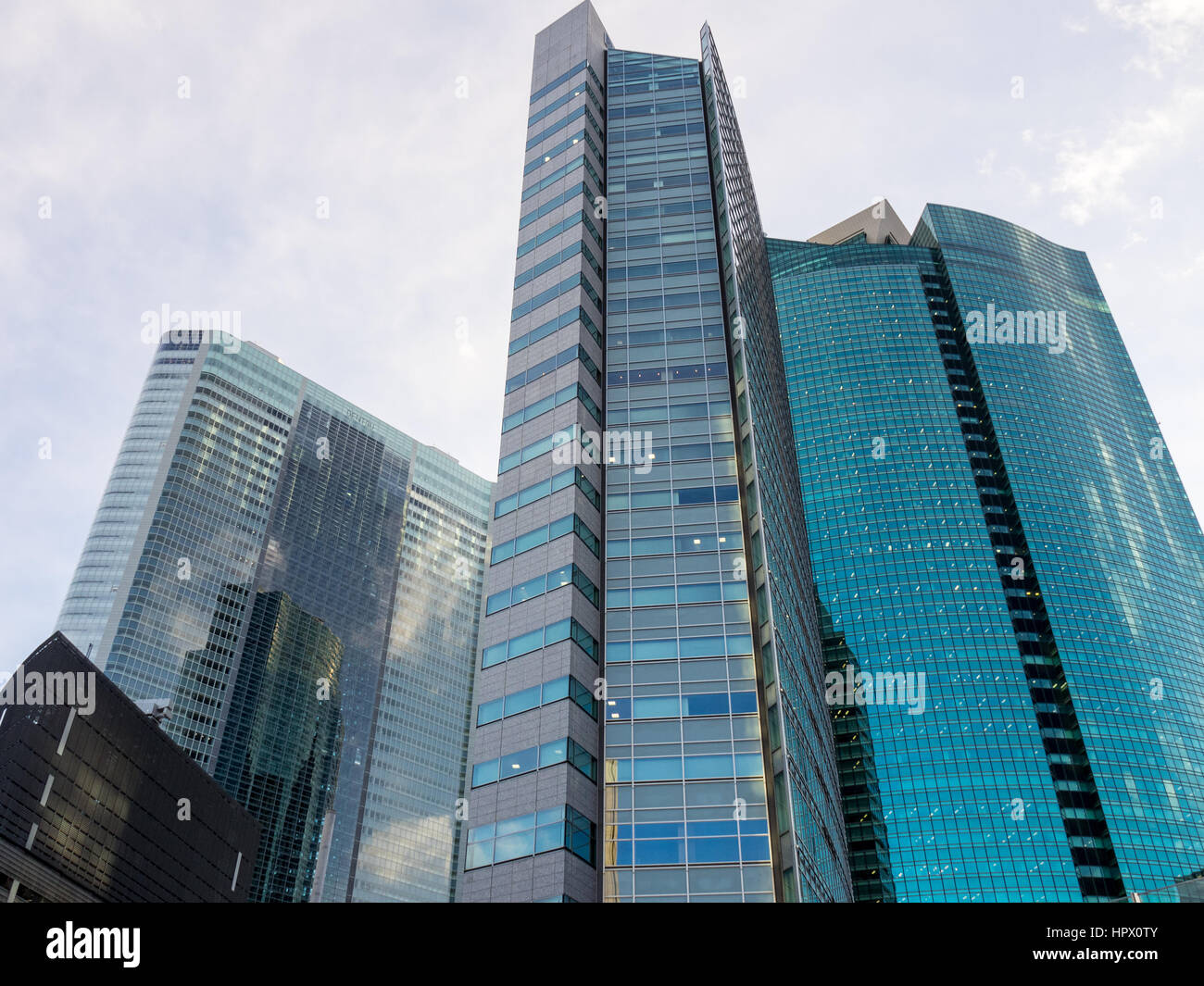 Glass facade of office towers in Minato, Tokyo. - Stock Image