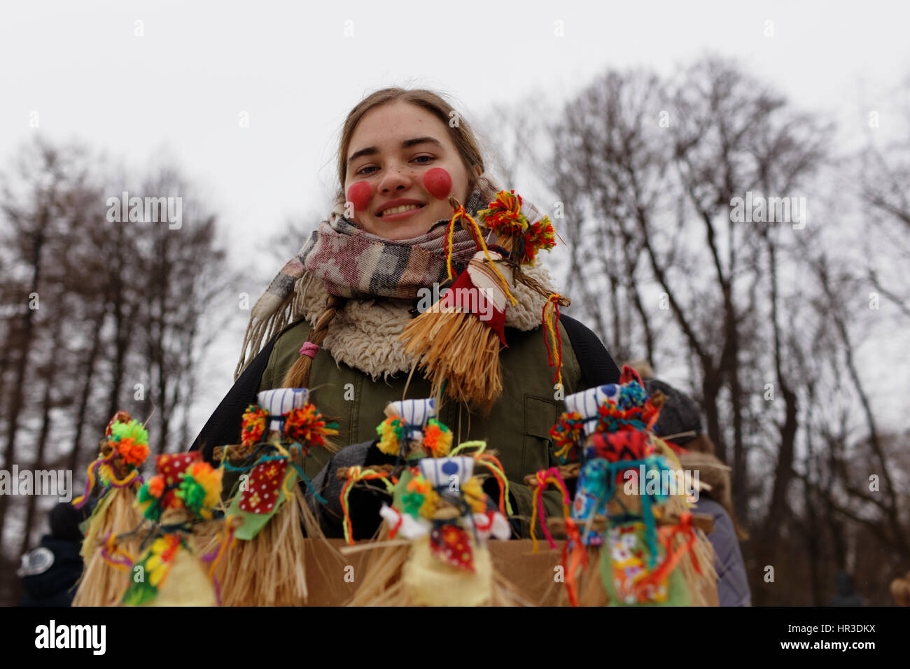 St. Petersburg, Russia, 26th February, 2017. Woman selling the effigies of Maslenitsa during Shrovetide celebrations Stock Photo