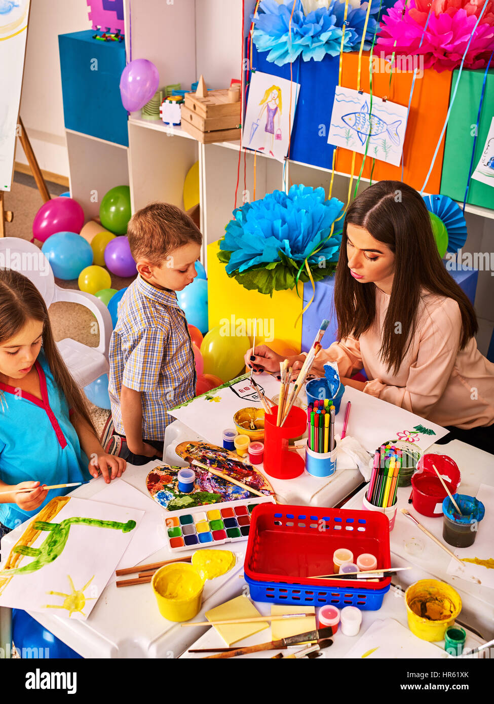 Childrens paint brushes and children painting and drawing in kids ...