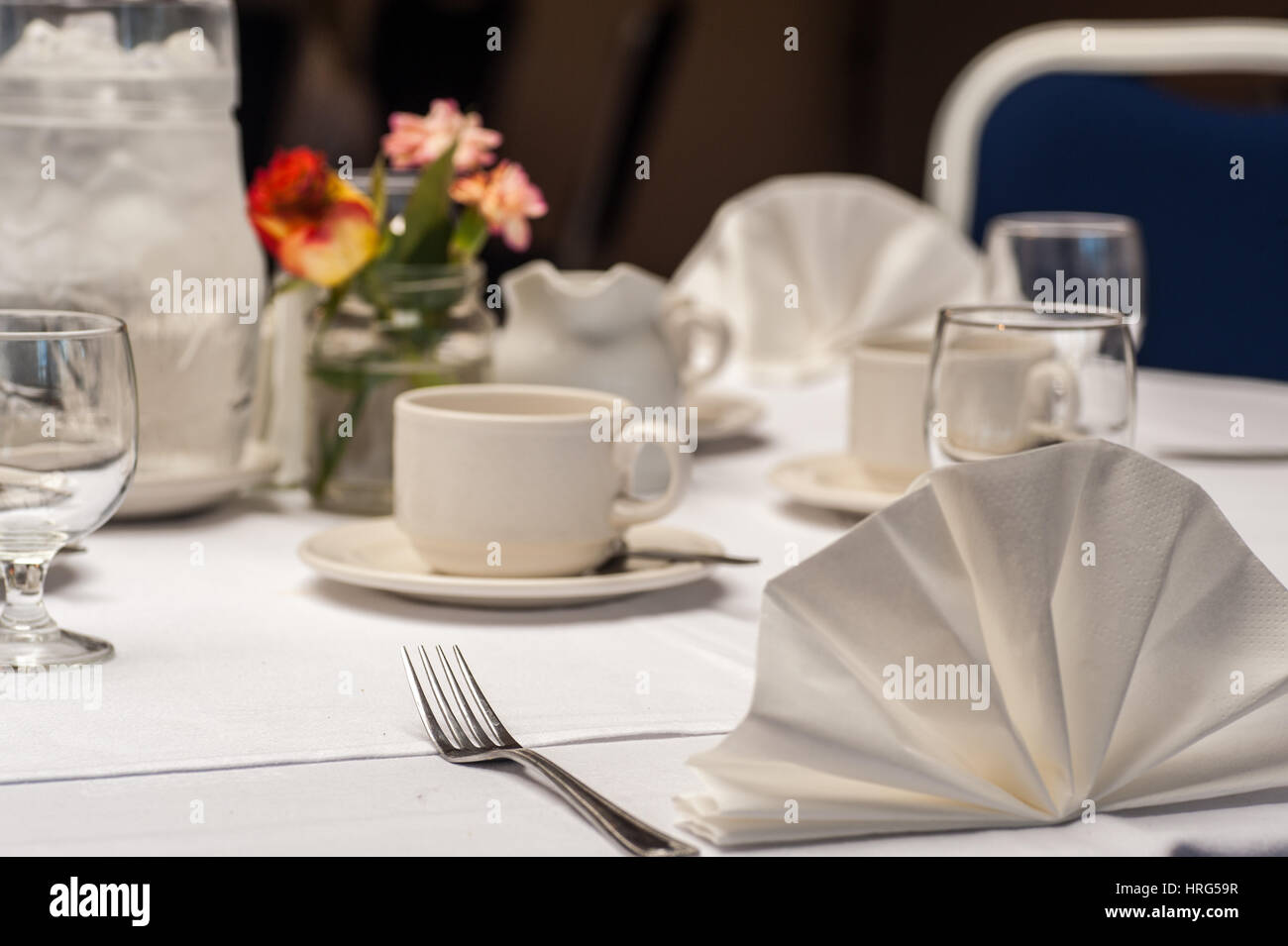 Place setting at a table for an event in a hotel. Stock Photo