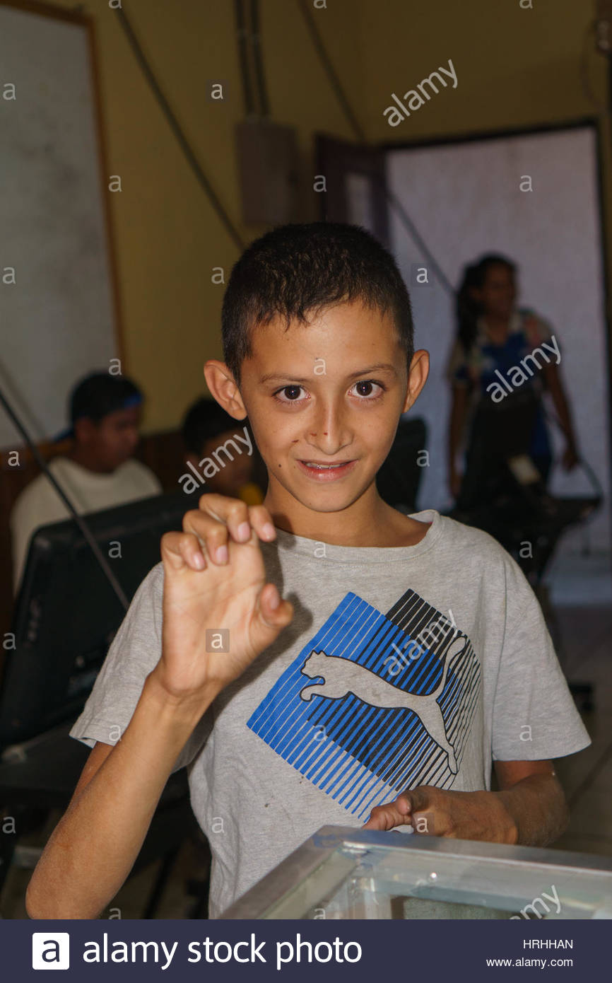 Nicaraguan deaf boy demonstrates Nicaraguan Sign Language. Stock Photo