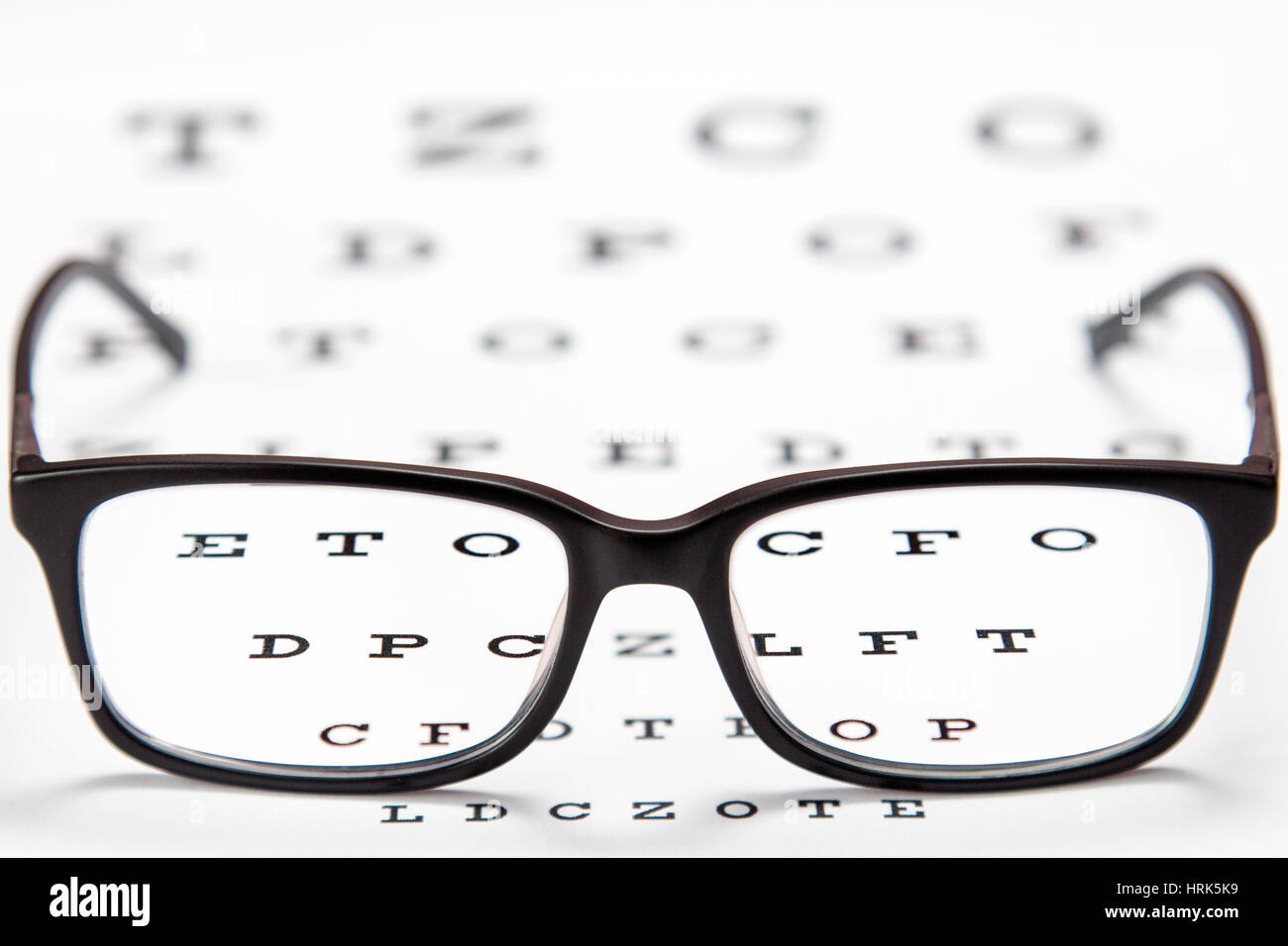 d945aaaa11 Glasses on a eye exam chart to test eyesight accuracy stock photo jpg  1300x956 Exam glasses