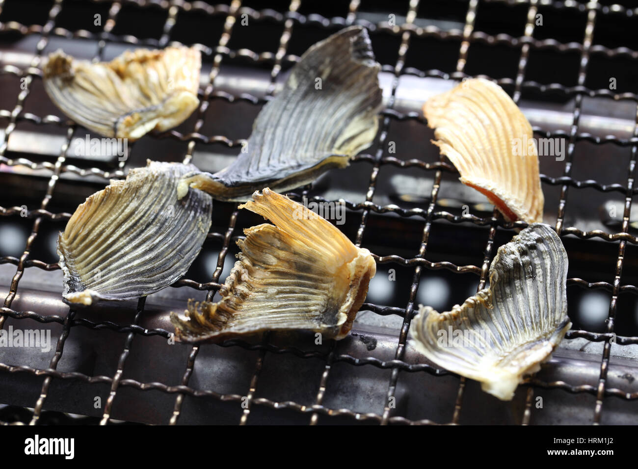grilling dried blowfish fins for Hirezake (japanese hot sake drink ) - Stock Image