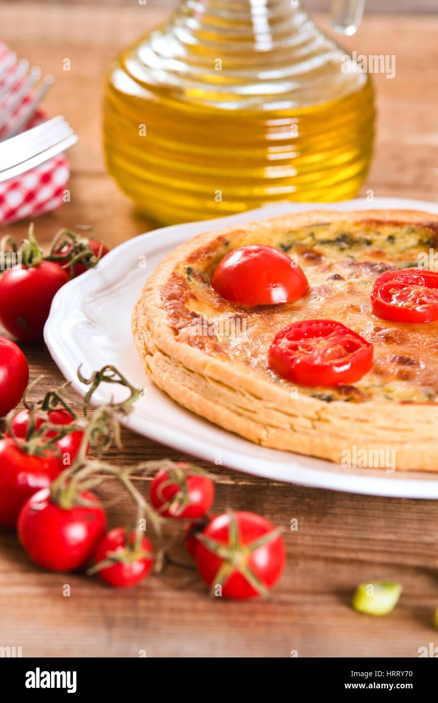 Leek and tomato quiche. - Stock Image