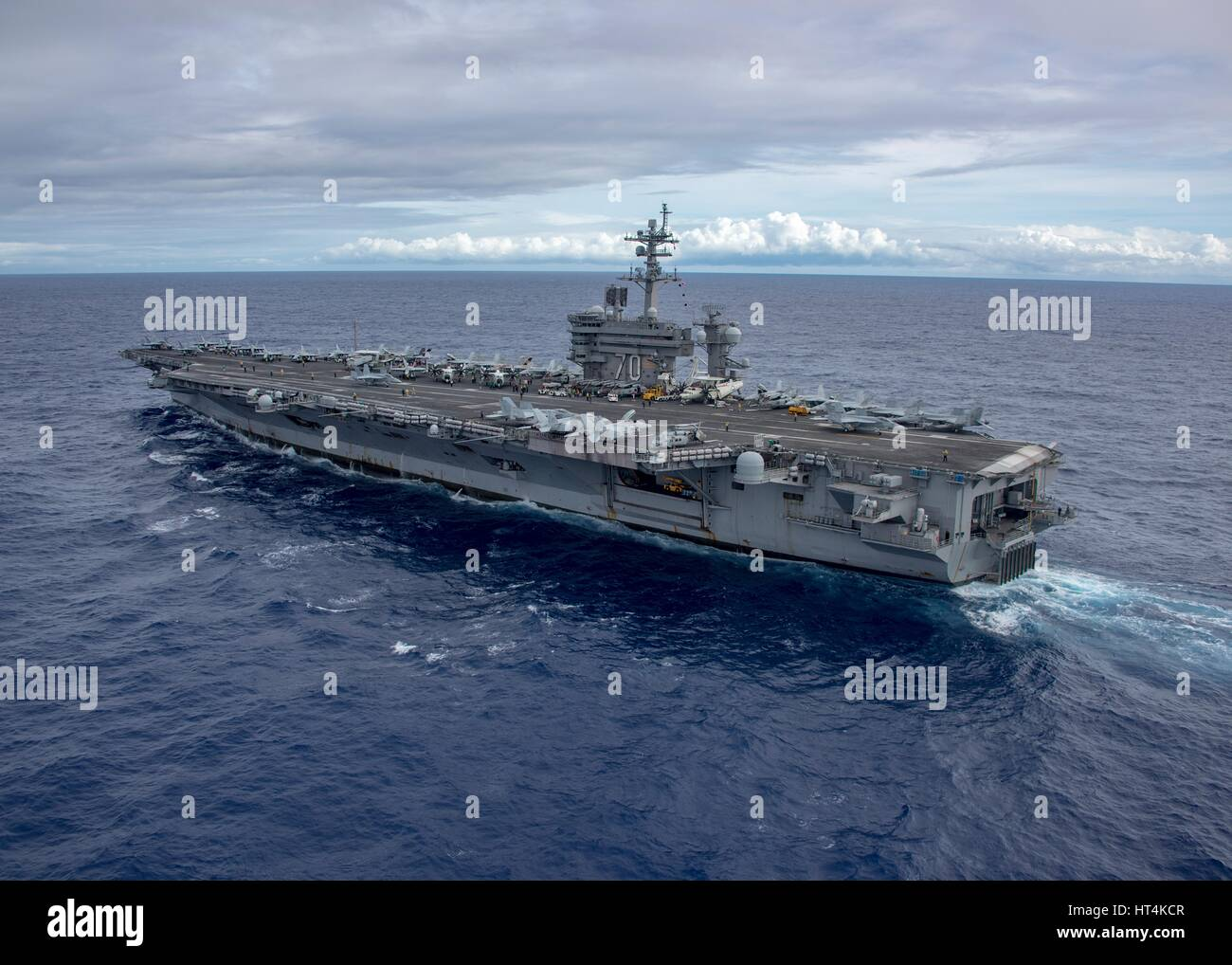 The USN Nimitz-class aircraft carrier USS Carl Vinson steams underway February 4, 2017 in the Pacific Ocean. - Stock Image