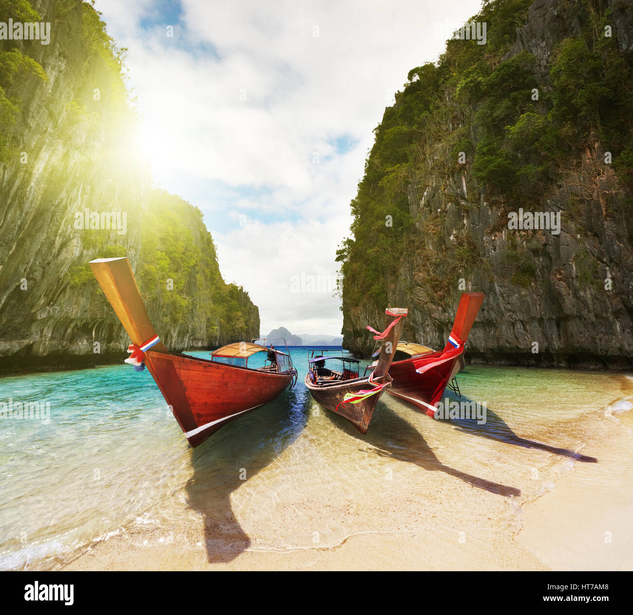 Boats on the beach inside small laguna - Stock Image