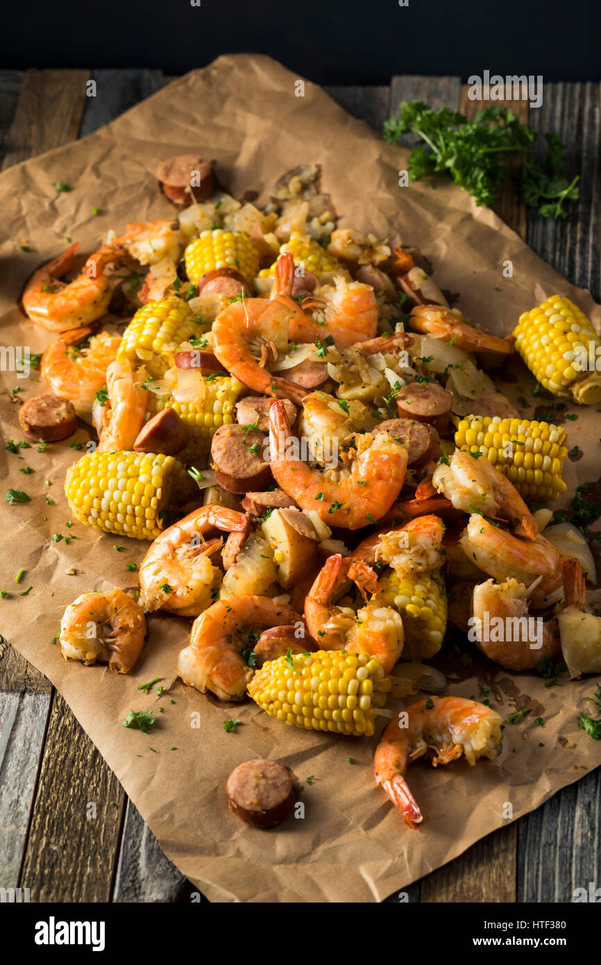 Homemade Traditional Cajun Shrimp Boil with Sausage Potato and Corn - Stock Image