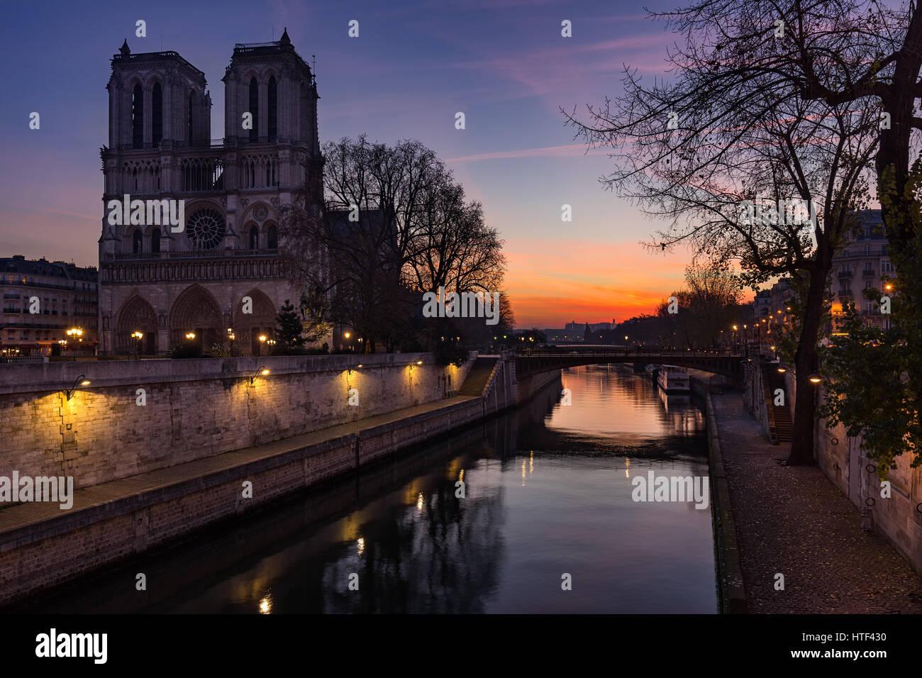 Notre Dame de Paris cathedral at sunrise with the Seine River. Ile de La Cite. 4th Arrondissement, Paris, France - Stock Image