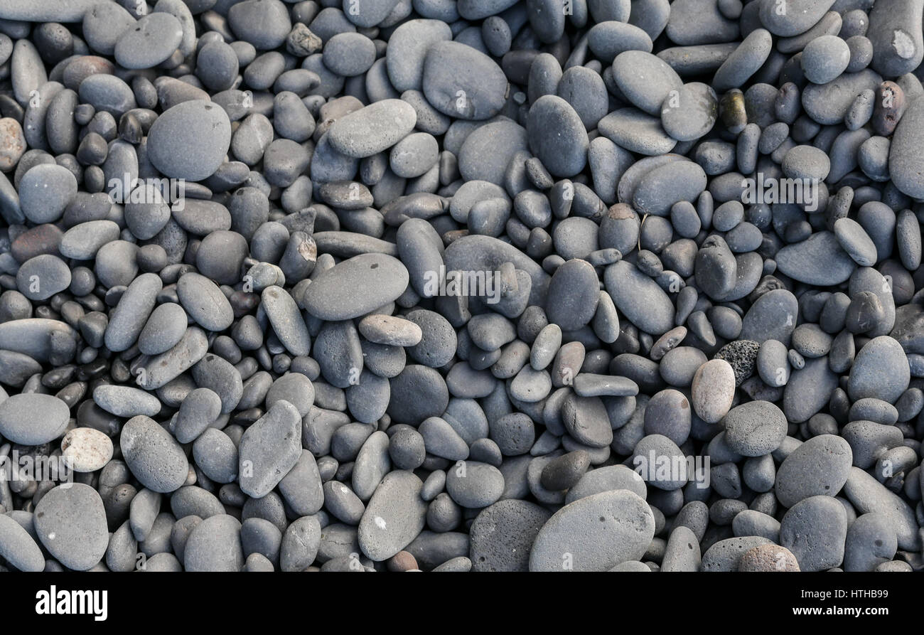 smoothed-black-lava-pebbles-on-beach-in-