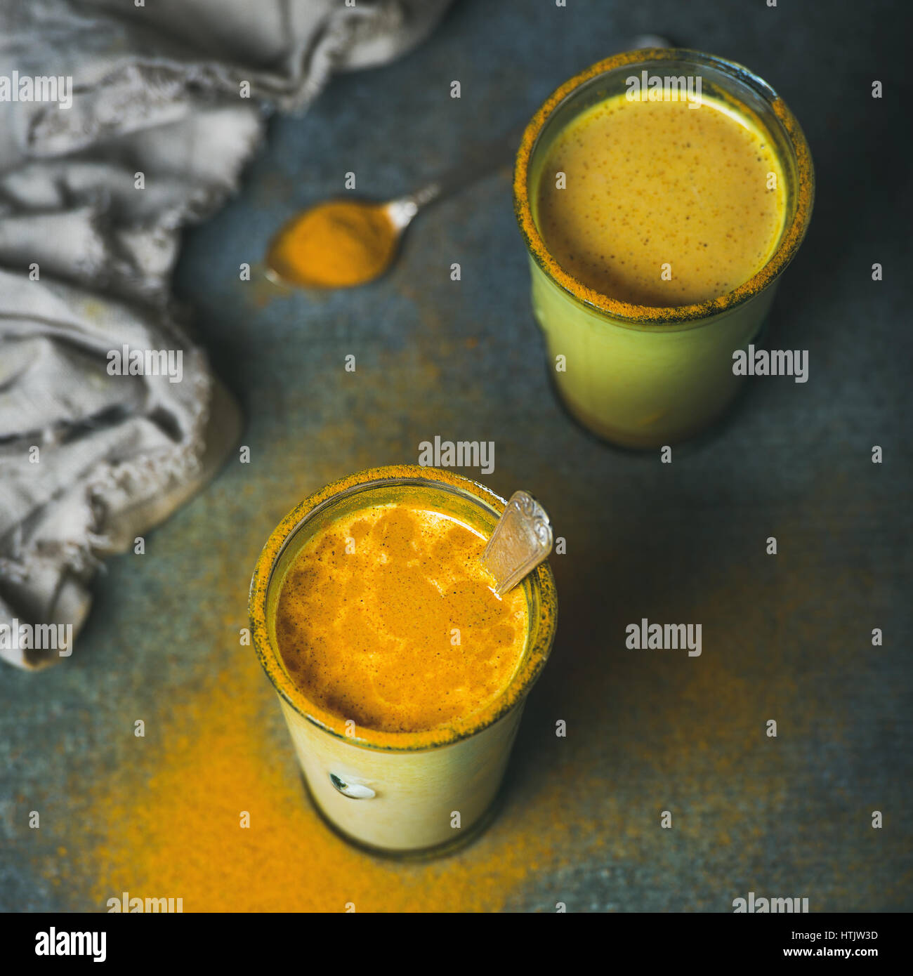 Golden milk with turmeric powder, dieting and weight loss concept - Stock Image
