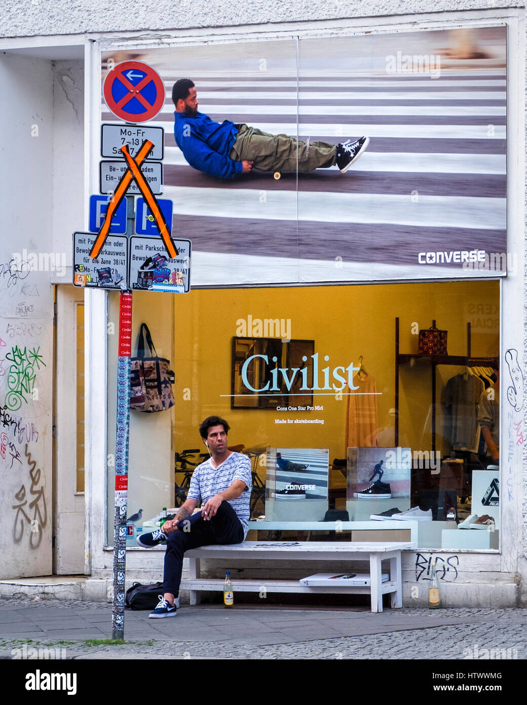 cadf86db0b103e Civilist shop selling Converse trainers and clothing. Exterior  advertisement and display window