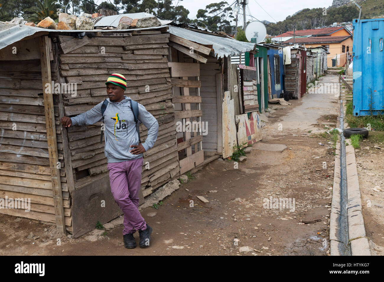 south-africa-townships-a-man-standing-in-the-street-imizamo-yethu-HTYKG7.jpg