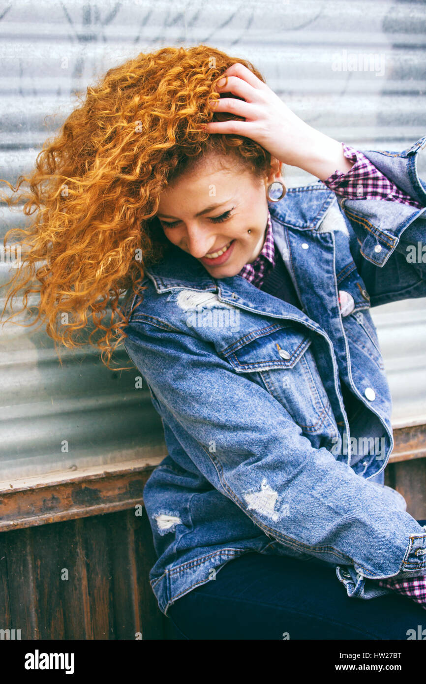Portrait of a young redhead grunge woman - Stock Image