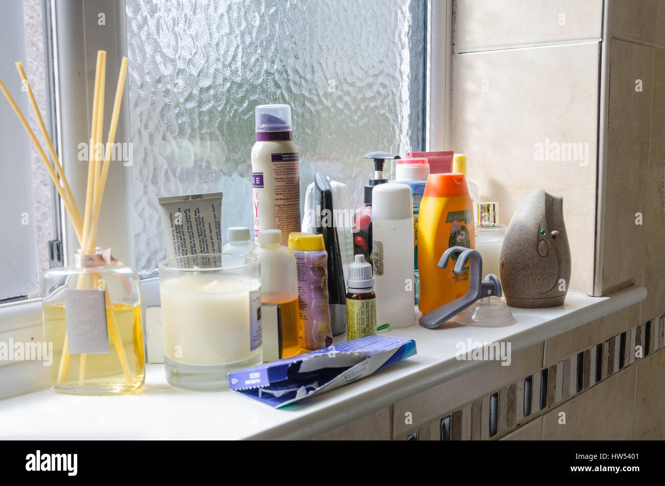 bottles-toiletries-soaps-and-lotions-on-a-bathroom-window-sill-HW5401.jpg