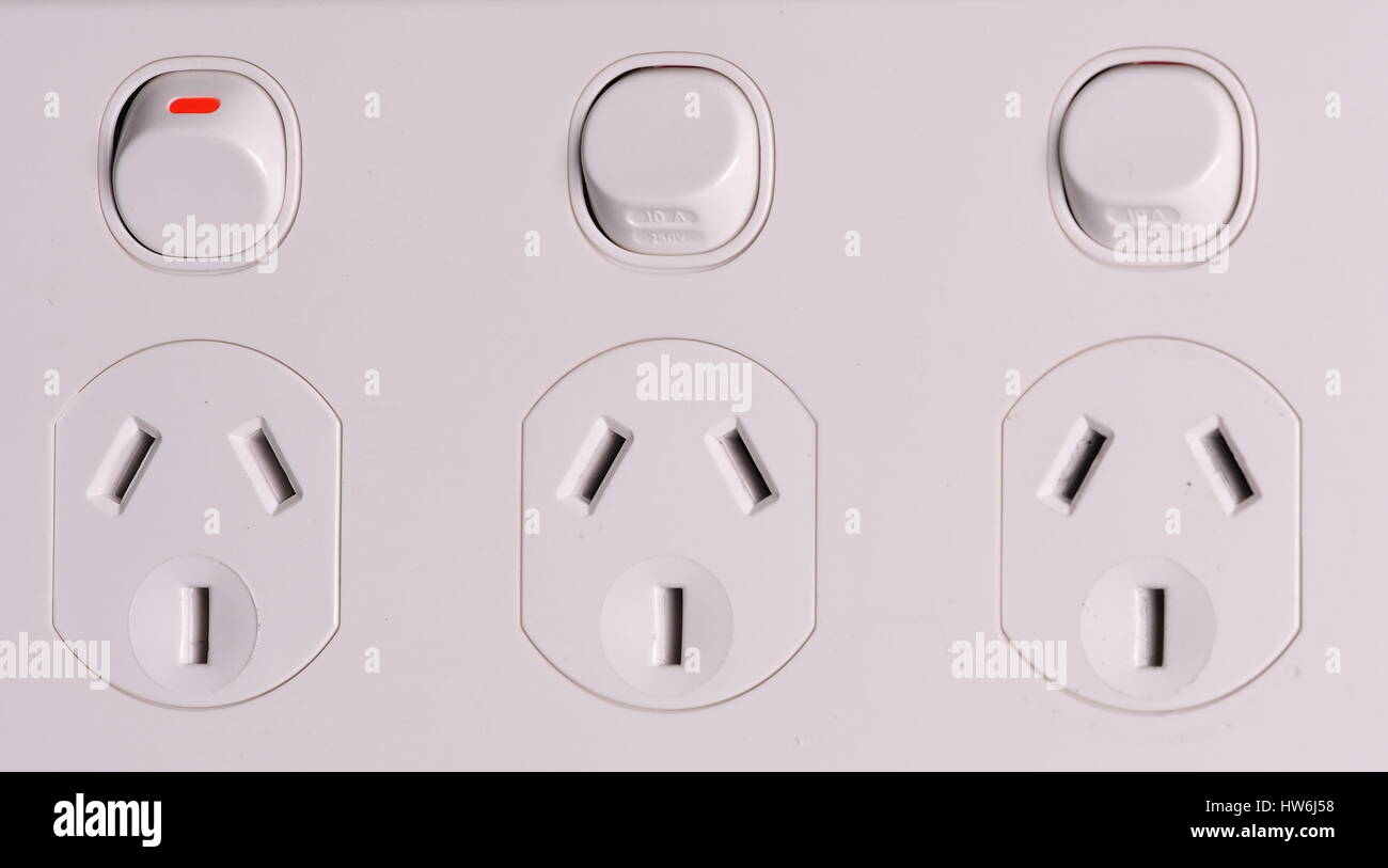Three fold low voltage power wall outlets with one switched on Stock ...