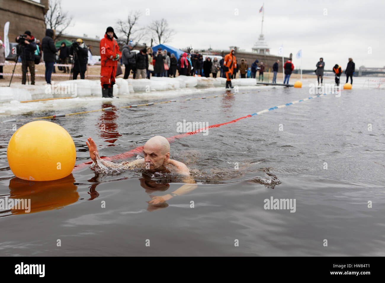 St. Petersburg, Russia, 18th March, 2017. People participate in a swim in river Neva at St. Peter and Paul fortress. Stock Photo