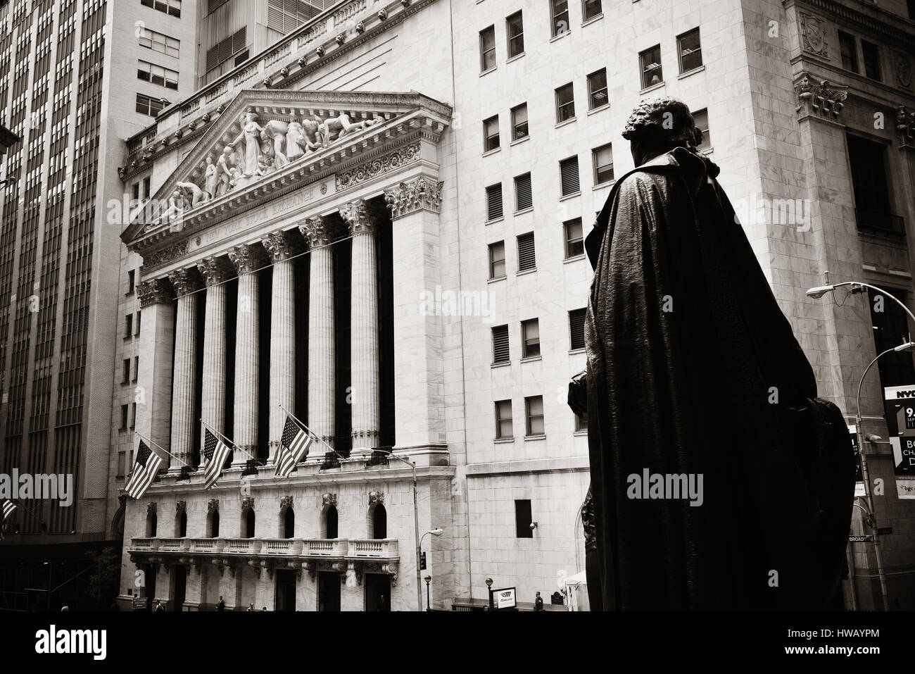 NEW YORK CITY - SEP 5: Wall Street with skyscrapers on September 5, 2014 in Manhattan, New York City. Wall Street - Stock Image
