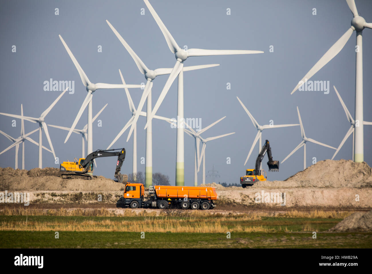 Huge wind energy power plant in northern Germany, east Frisia, North Sea coast, construction, Stock Photo