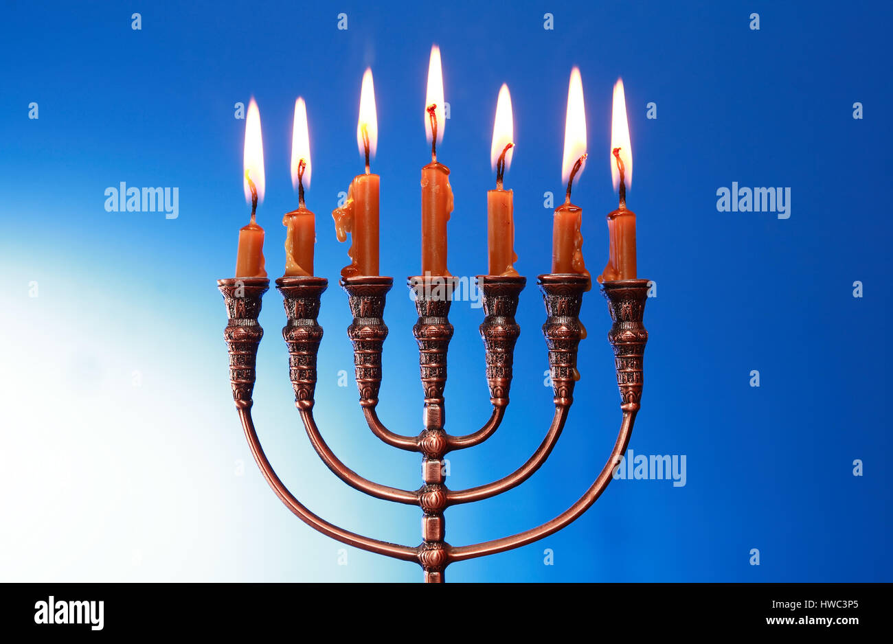 Traditional Jewish Menorah With Lighting Candles On Nice Blue Background
