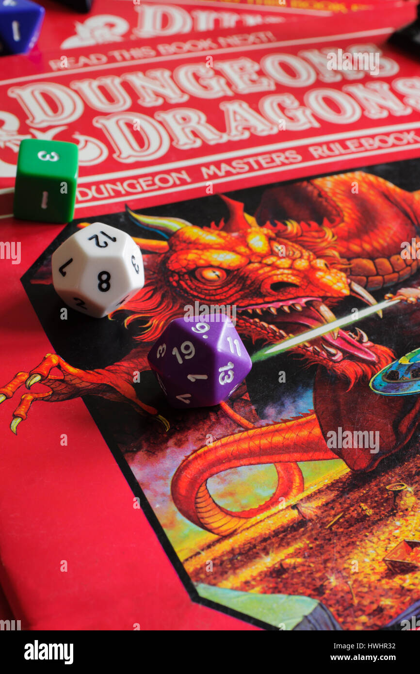 Vintage Dungeons and Dragons dungeon masters rule book published as part of a D&D game pack in 1983 with multi sided Stock Photo