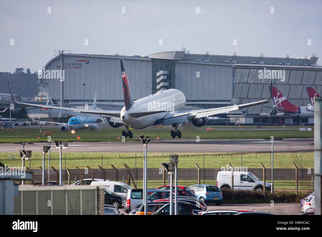 Delta Air Lines Boeing 767-332/ER landing at London Heathrow Airport, UK - Stock Image