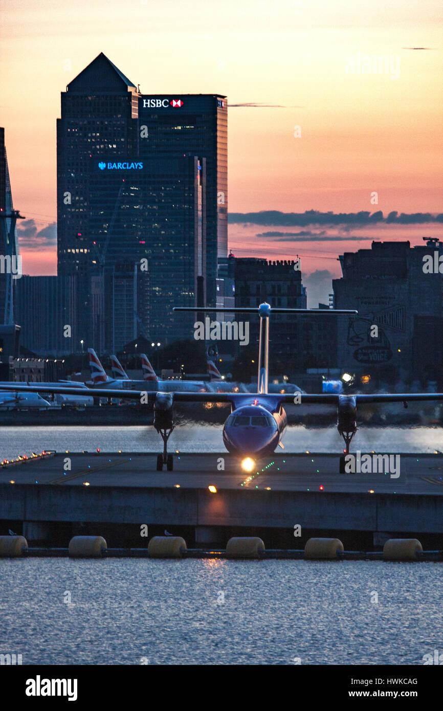 Airplane landing at London City Airport, UK - Stock Image
