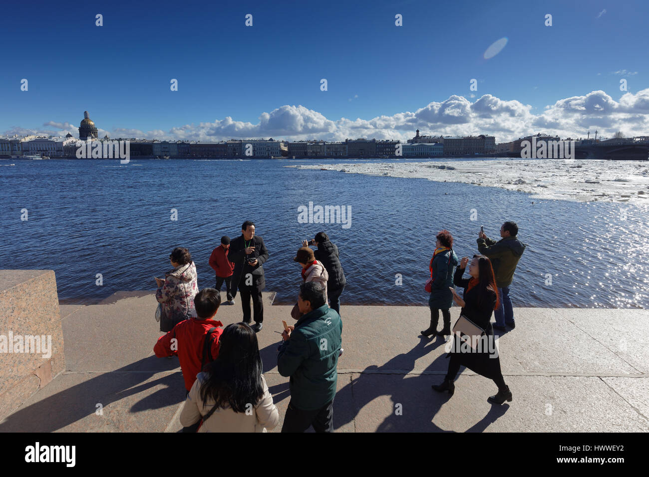 St. Petersburg, Russia, 23rd March, 2017. Chinese tourists make photos on the embankment of river Neva during the Stock Photo