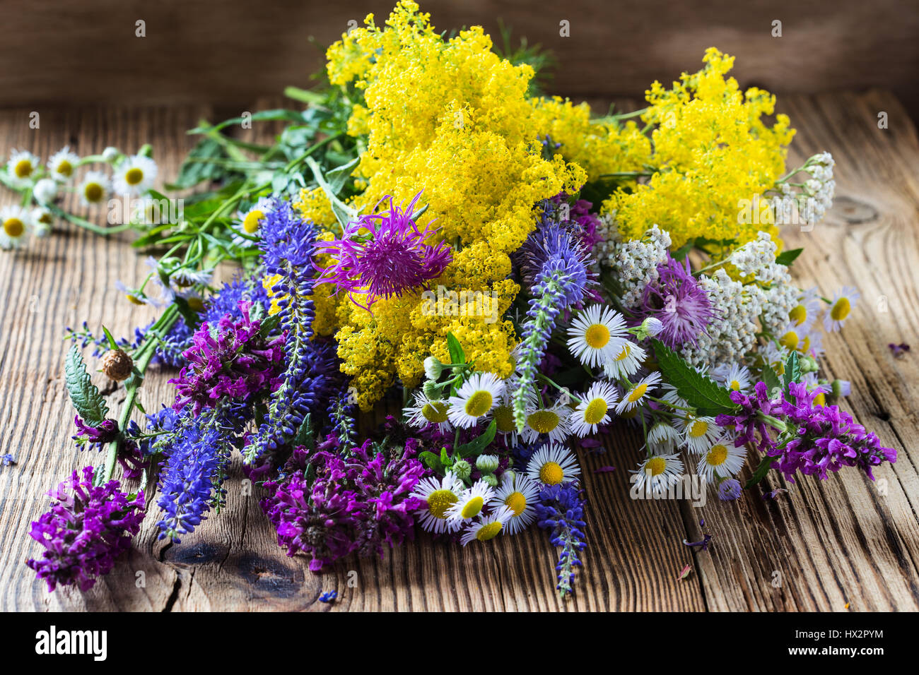 Summer meadow flowers bouquet on rural wooden background Stock Photo ...