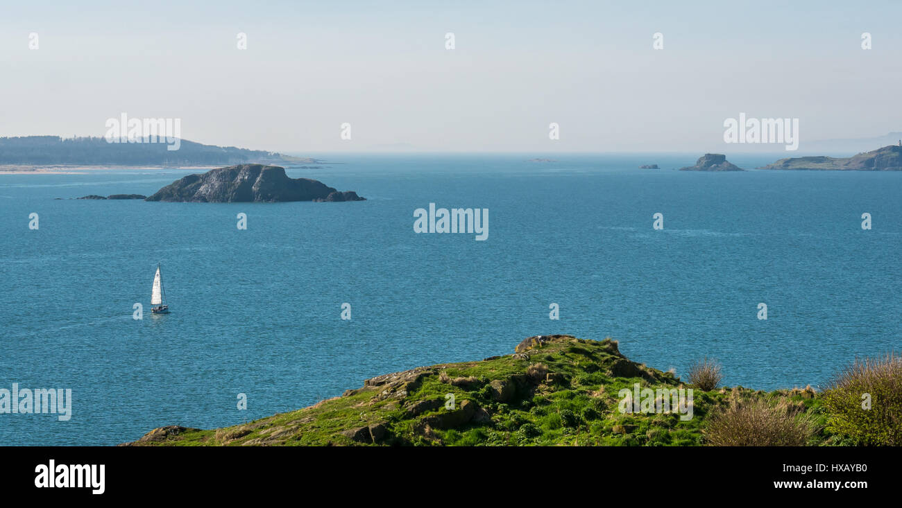 solitary-sailing-boat-with-sail-up-at-se