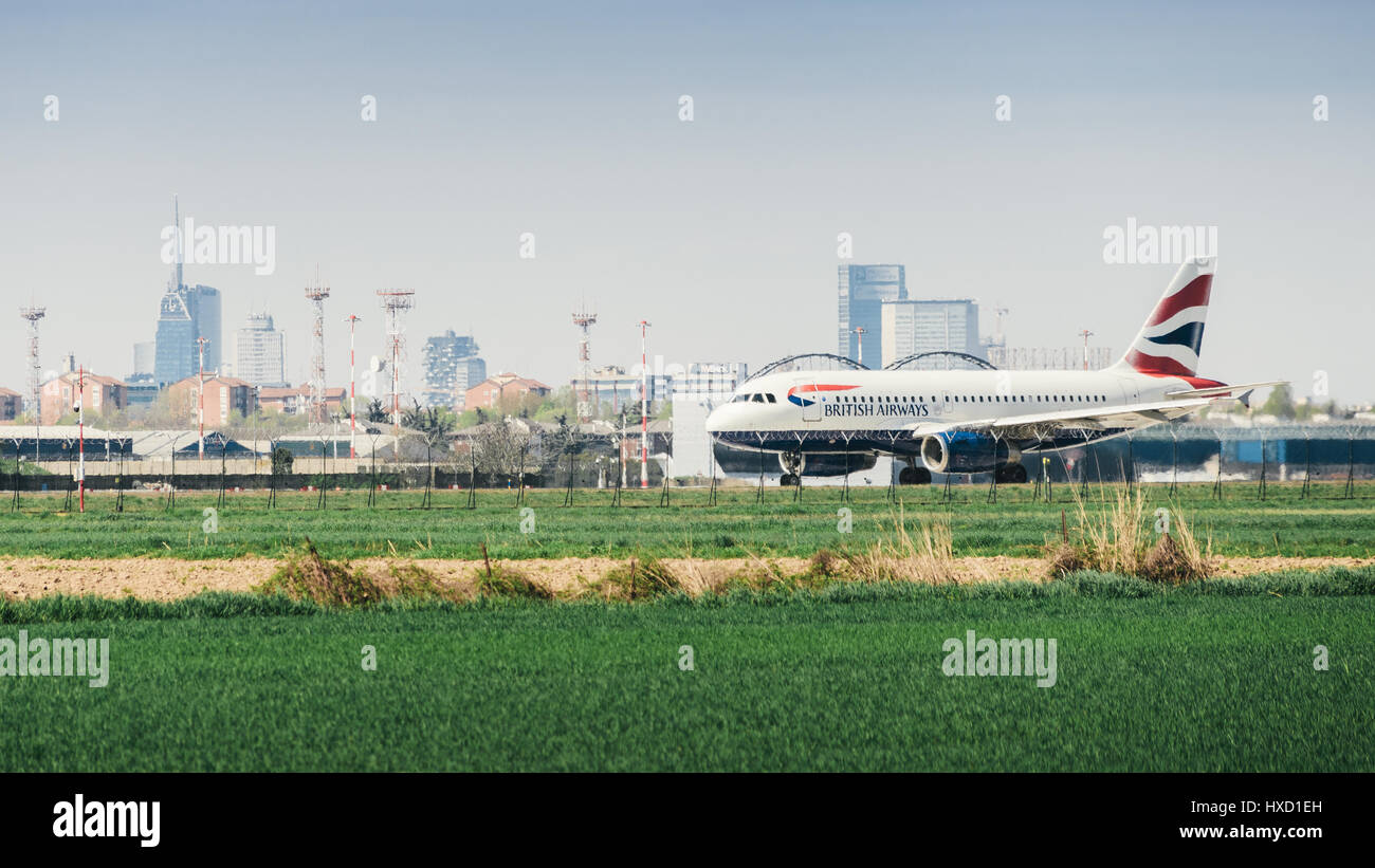 A British Airways commercial airplane takes off from Milan's Linate airport. Linate is a main hub for Alitalia servicing Stock Photo