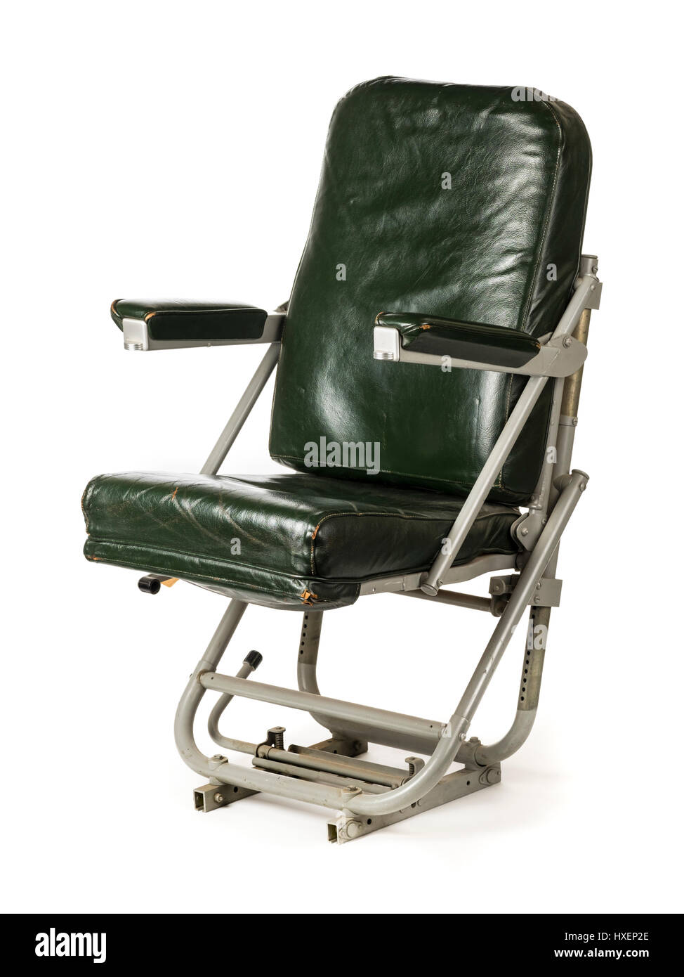 WW2 Royal Air Force DC-3 Dakota aircraft spring-loaded co-pilot seat with green leather upholstery. Manufactured - Stock Image