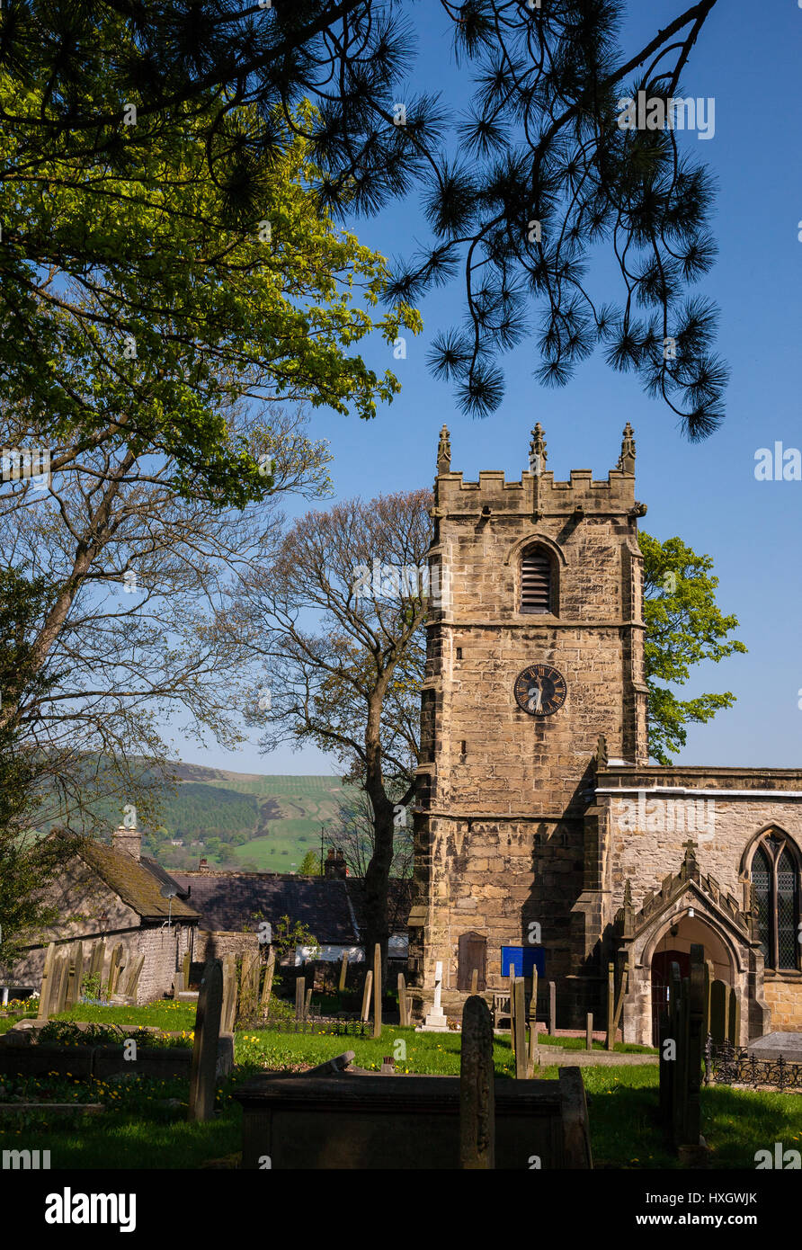 Eyam parish church of Saint Lawrence in the Derbyshire Peak District UK - Stock Image