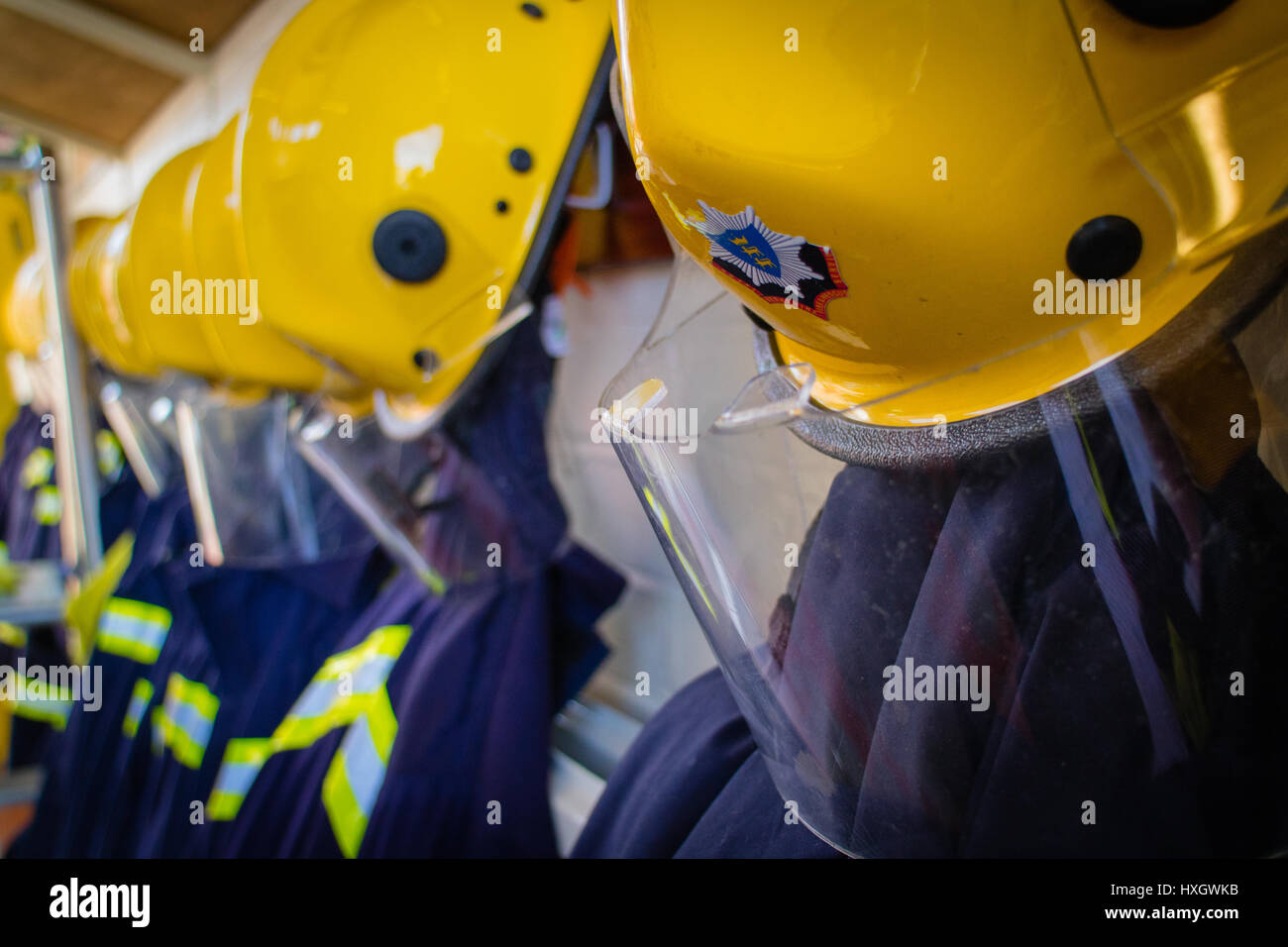 Royal Berkshire Fire and Rescue firefighter uniforms and helmets. - Stock Image